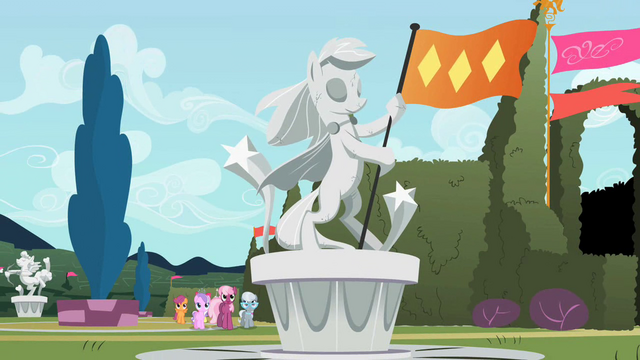File:Statue of a pony holding a flag S2E01.png