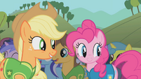 Applejack and Pinkie laughing at Spike S1E11