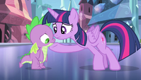 Twilight with hoof under Spike's chin S4E24