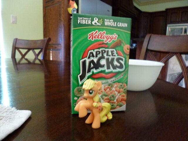 File:Applejack in front of Apple Jacks Cereal.jpg