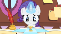 Rarity looks at a spool of rainbow-colored thread S4E08