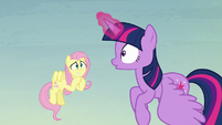 Twilight surprised; Fluttershy grinning nervously S5E23