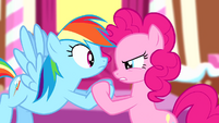 Pinkie Pie staring seriously at Rainbow S4E12