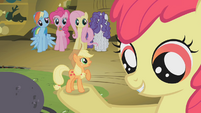 Tiny Applejack in Apple Bloom's hoof S1E09