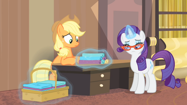 File:Rarity putting rolls of fabric onto a table S4E08.png