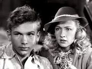 Frankie Thomas as Ned (then called Ted) Nickerson and Bonita Granville as Nancy Drew in the 1939 movies