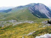Contrast between north i south slopes, southern slopes soft i grassy in spring covered sa carpets of flowers., northern slopes are steep sa cliffs i scree slopes, behind is highest peak V.Sator (20568)