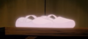 Dorothy's magic shoes glow before she is whisked to Ev in 1986 anime series