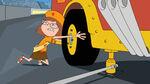 Gretchen changes a tire