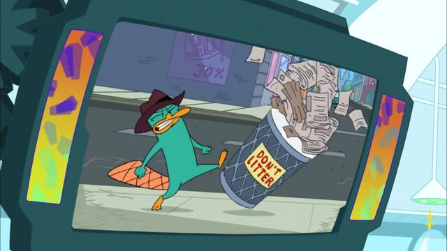 File:Perry lookalike knocking over trash can.jpg