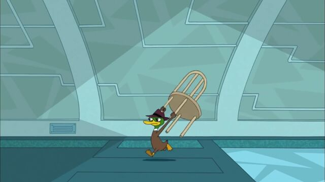 File:A duck agent chasing Perry while carrying a chair.jpg