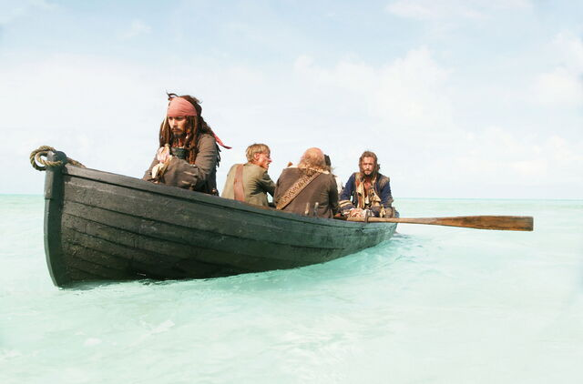 File:Captain Jack Sparrow and crew in the boat.jpg