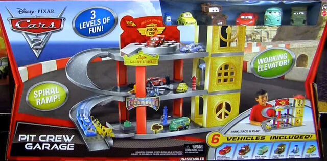 File:Cars2LuigiPitCrewGarage.jpg