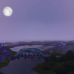 Wschodzący księżyc oświetlający most