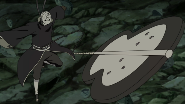 File:Obito Using Madara's Gunbai.png