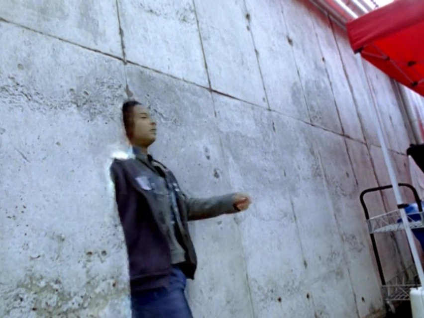 File:Jack moving through a wall using his phasing powers..jpg