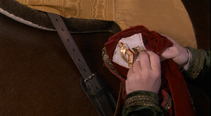 Vizzini planting fabric from a Gulider army uniform on Buttercup's horse