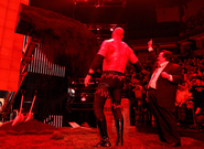 Kane and Paul burying Undertaker