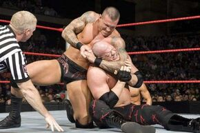Randy orton performing a chinlock on kane