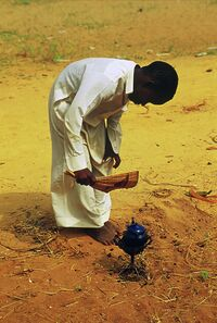 African Kid Making Tea