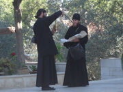2 priests checking merchandise
