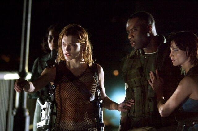 File:Alice tells the others that she senses that something's there.jpg