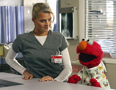 File:8x5 Denise looks at Elmo.jpeg