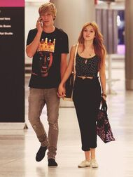 Bella-thorne-Bristan-holding-hands-on-photne