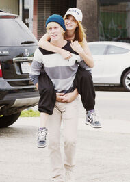 Bella-thorne-piggyback-ride-(2)