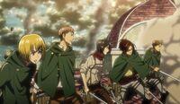 The soldiers watch Eren fight Annie