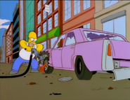 Homer destroying car