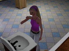 Sim brushing her teeth