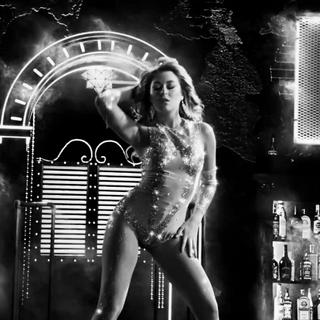 Gilda dances.
