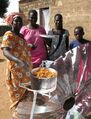 Cucinare con il Sole, villagers with first solar meal, 1-21-14 .jpg