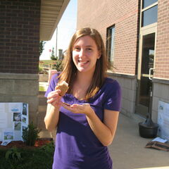 Kelly enjoys a s'more from one of her classmate's cookers.