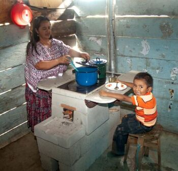 Helps International-stove-mother-and-boy