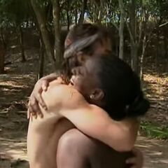 Shane hugs Cirie after catching her fish