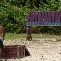 Phillip starts tossing sandbags for Bikal.