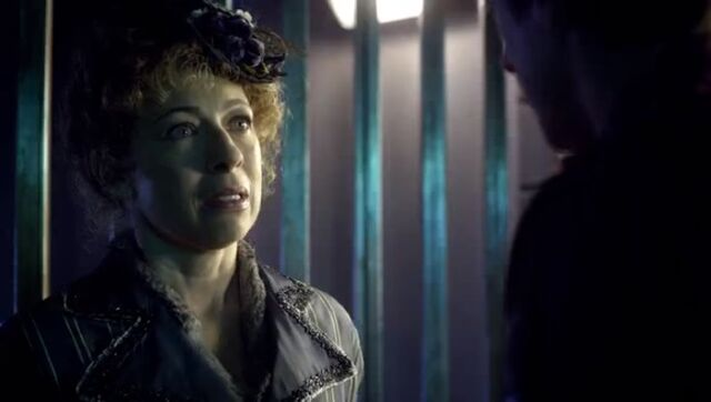File:River tells Rory she can't help the Doctor.jpg