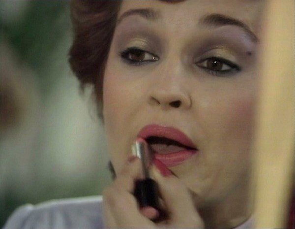 File:Tegan applying lipstick The Visitation.jpg