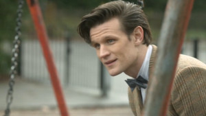 File:Eleventh Doctor on swings The Bells of Saint John A Prequel.jpg