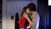 The Doctor and Amy kiss