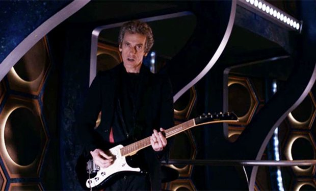 File:Doctor playing electric guitar in the TARDIS.jpg