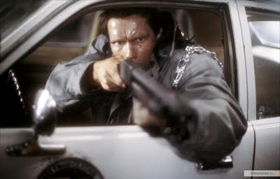 File:T-800 t1 shoting a shot gun.jpg