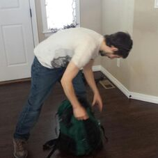 A picture of joe packing his book bag on James' twitter account
