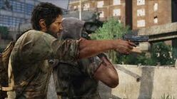Joel taking a hostich wtih a pistol