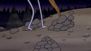 S4E32.075 Benson Knocking Over a Pile of Rocks