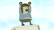 S4E34.053 Muscle Man Holding Two Donuts