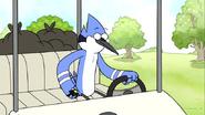 S03E16.026 Mordecai Checking His Phone