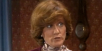 Mrs. Layton (wife of Larry's boss)